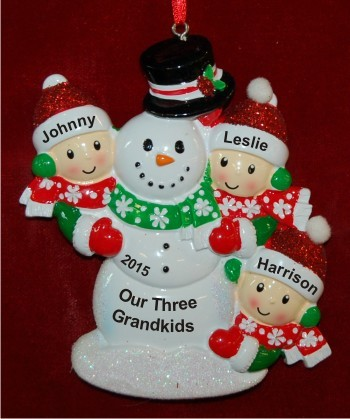 Our 3 Grandkids Building Large Snowman Christmas Ornament Personalized by Russell Rhodes