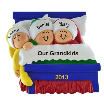 3 Grandkids Snuggled in Bed Christmas Ornament Personalized by Russell Rhodes