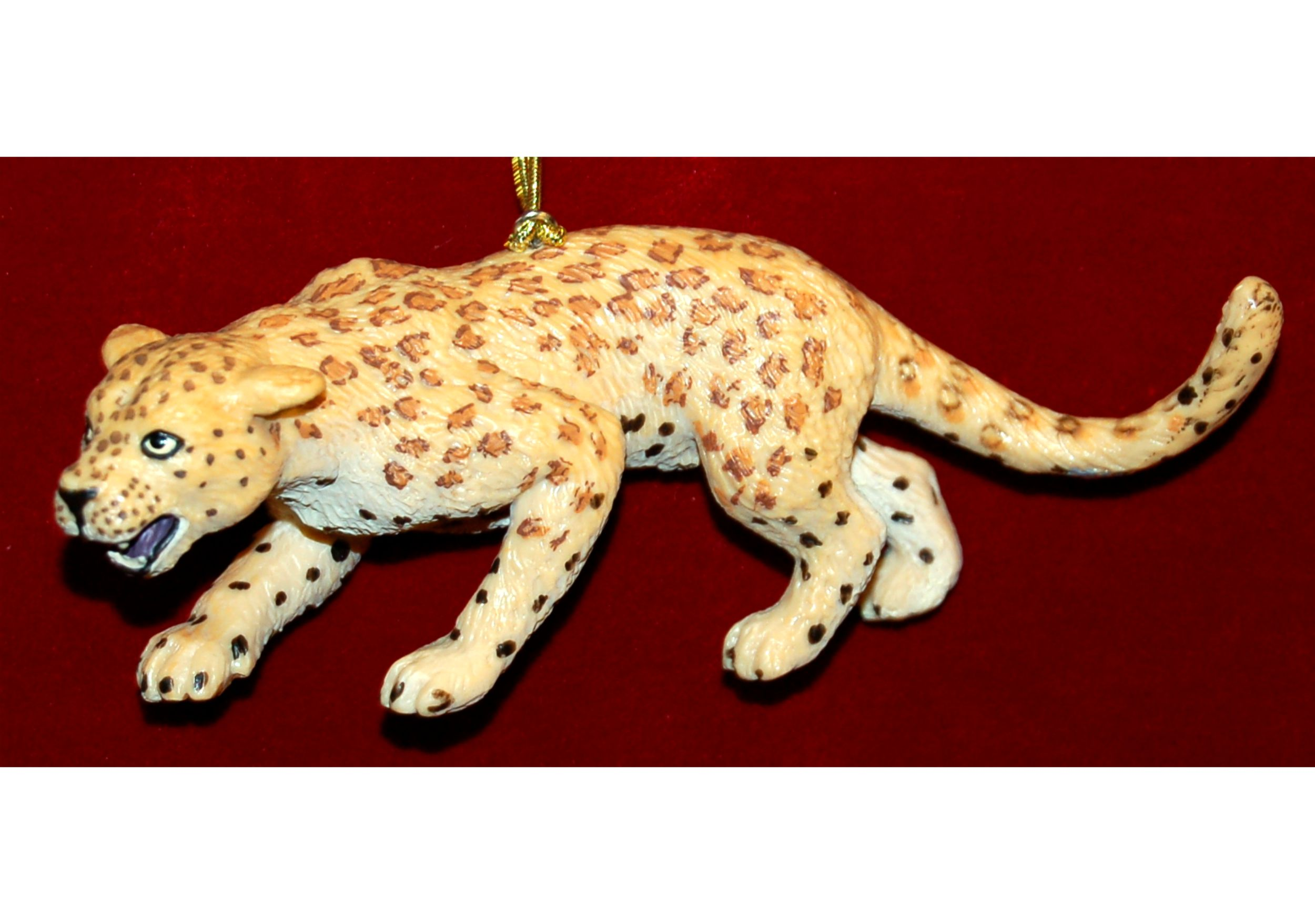 Leopard Christmas Ornament by Russell Rhodes